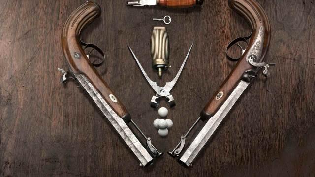 Deko Duellpistolen mit Werkzeug mit Ladezubehör